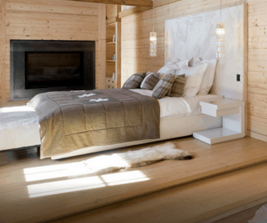 Master Suite bed with fur headboard and tv in the background