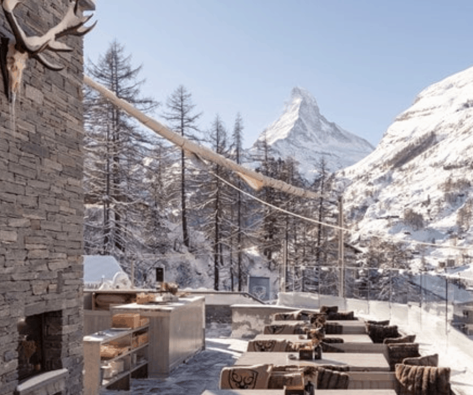 View of Matterhorn Mountain in Switzerland from outdoor lounge area at Hotel Cervo, Zermatt