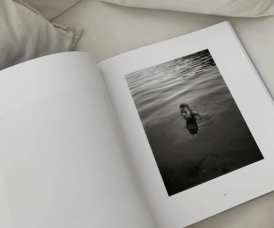 Open coffee table book with an image of model Kate Moss