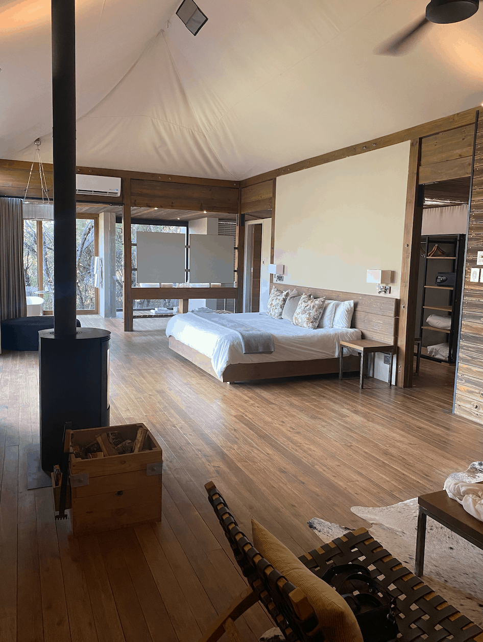 Large bedroom with firceplace, sitting area and bed