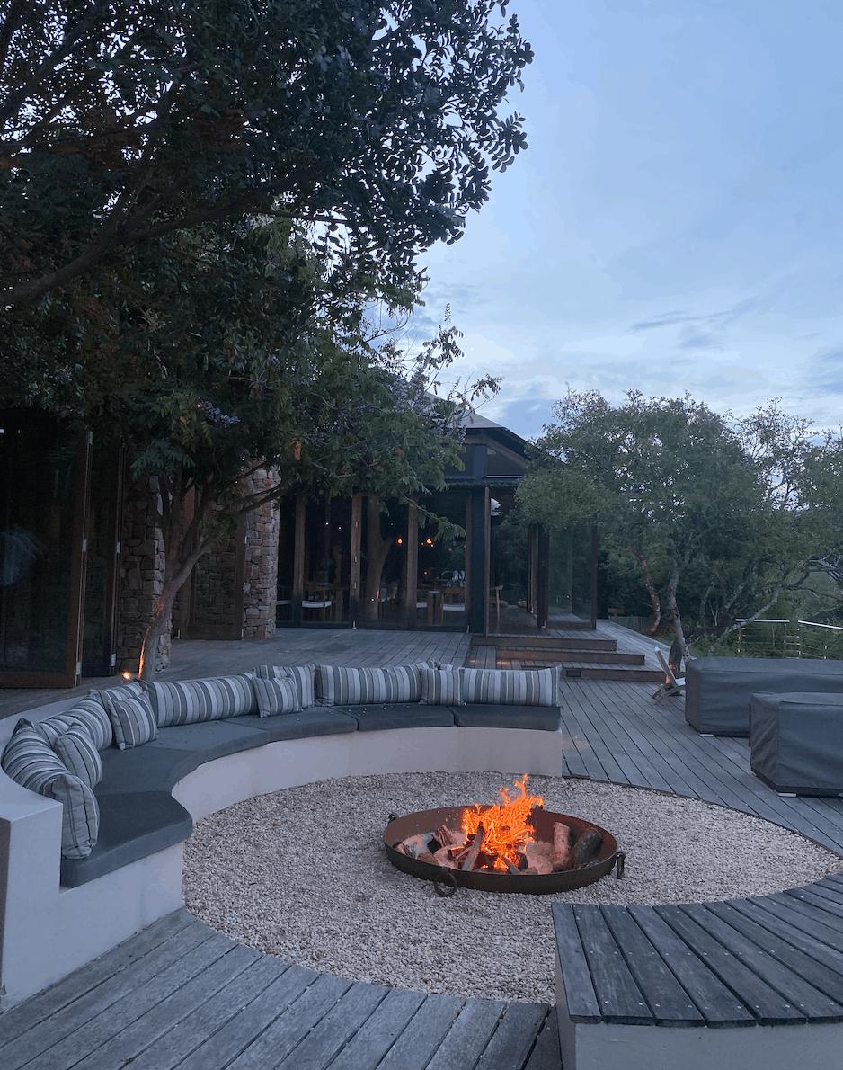 Fireplace burning outdoors in beautiful nature setting