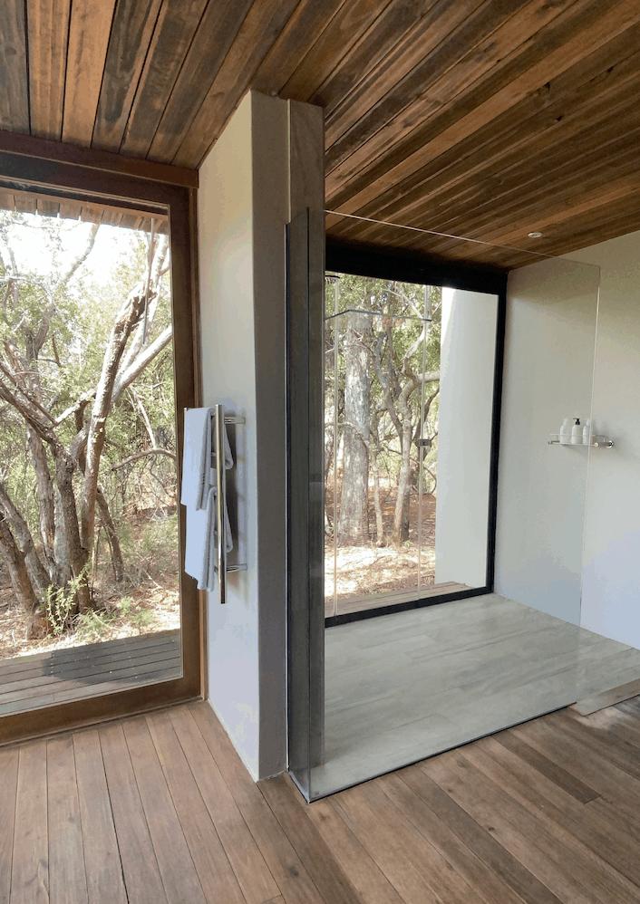 Indoor outdoor shower area with view